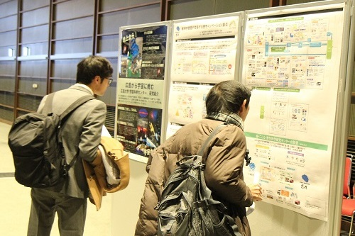 Participants reading research posters.
