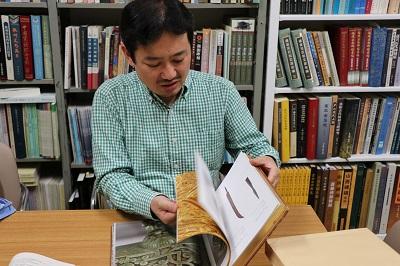 Associate Professor Funada looking through historical materials.