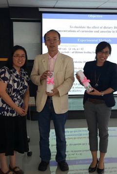 Receiving souvenirs from Asst. Prof. Masubon (left) after the lectures