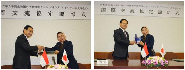 左:協定書を交換 右:研究科から記念品の贈呈